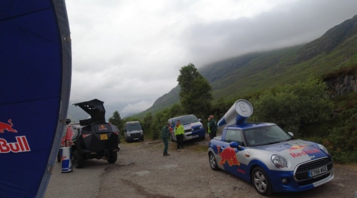 Red Bull Cars in a car park in the Scottish mountains.